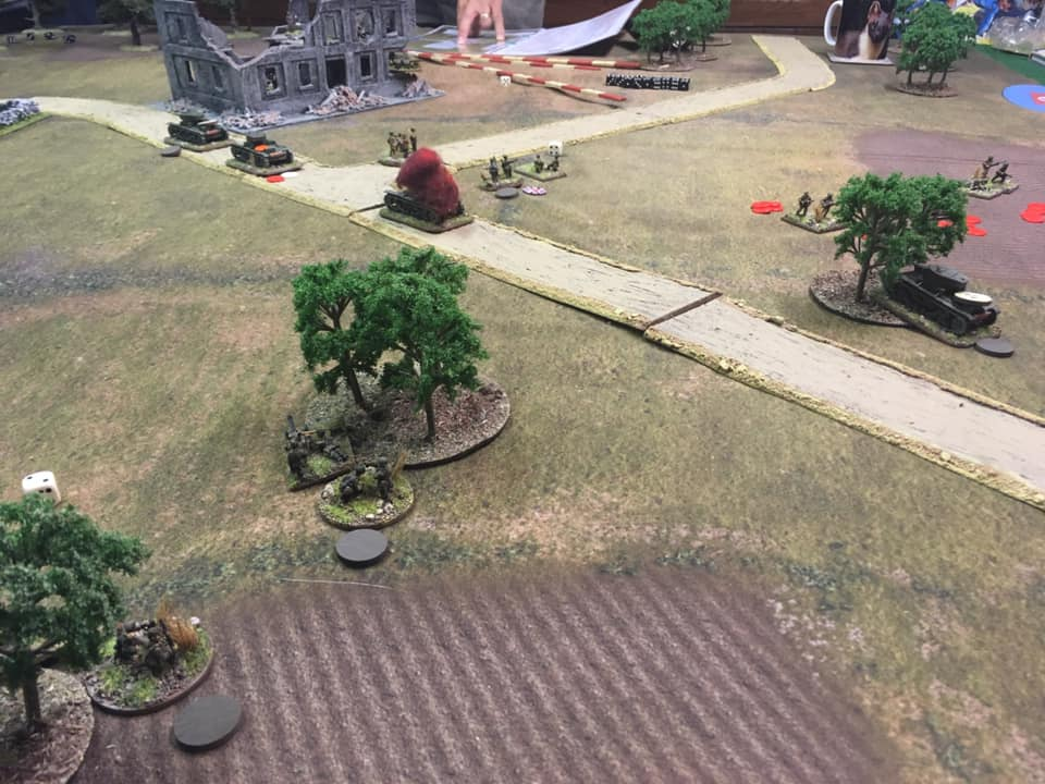 Right flank assault fails with infantry platoon falling back in retreat leaving the Commissar stunned.