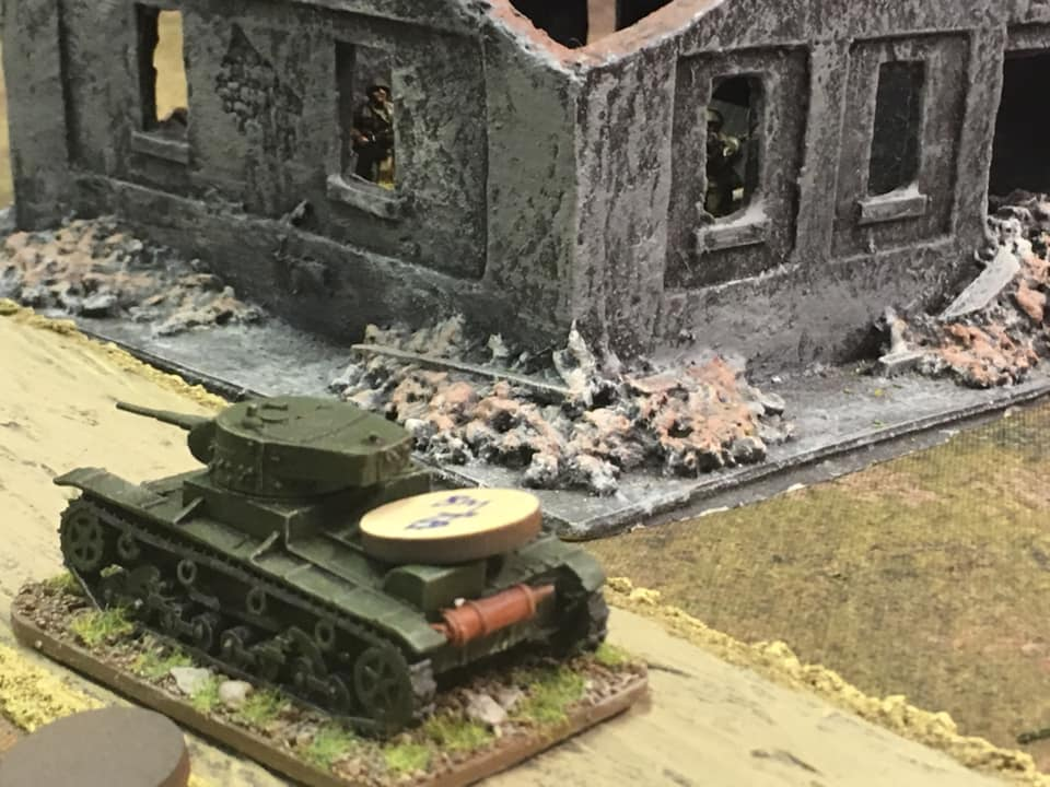 Tank platoon leader's vehicle attempting to pass the fortified house and making a dash for the main objective beyond.