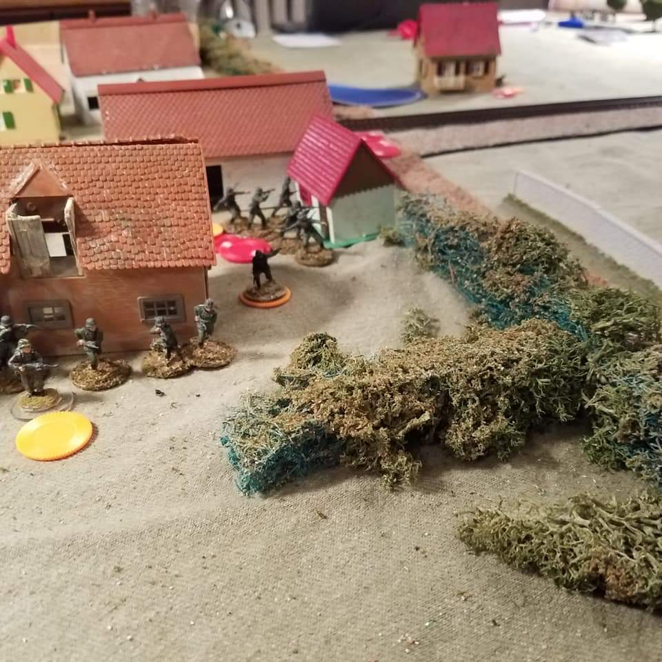 After routing one Ranger squad, the Germans were hit by rifle fire from 116th Regimental Combat Team and retreated back into houses.