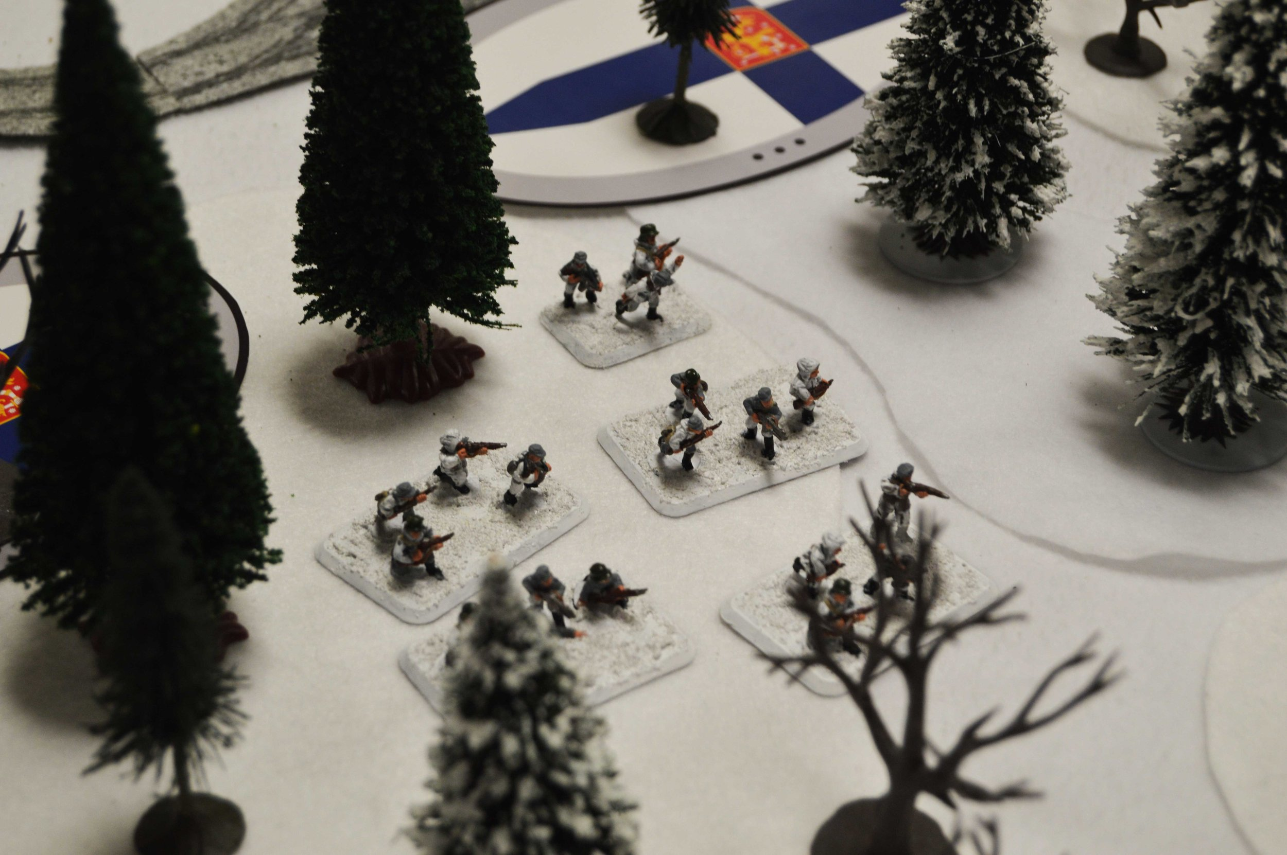 The Finnish infantry begin to appear in the woods near their starting position.