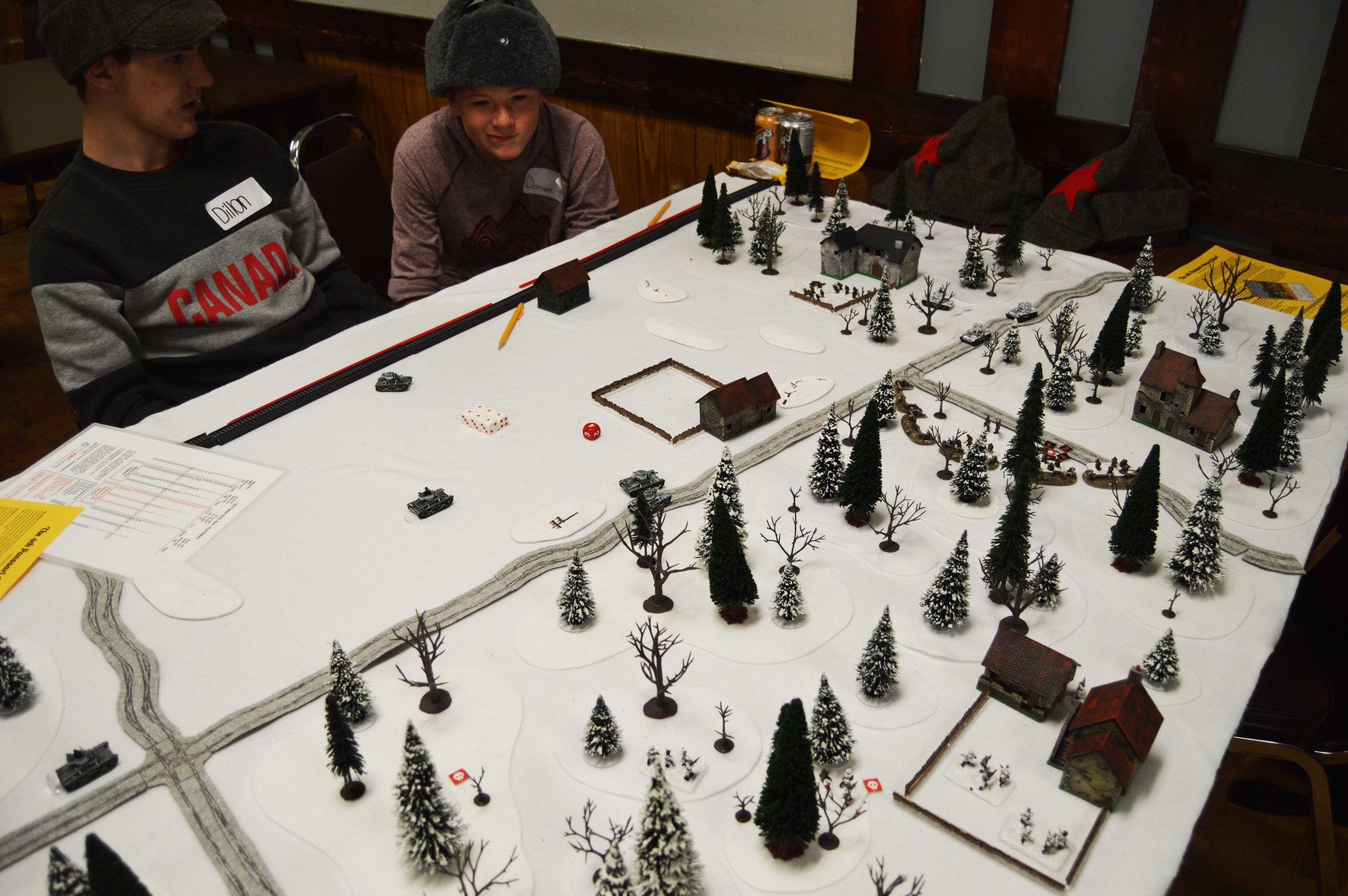 The positions around mid-game. The Finnish infantry in the woods have entered the buildings and are using these positions to pour fire on the remaining Soviets in the trenches. Lt. Mikkola's tank is still stuck by the crossroads and Cpl. Seppälä's tank is very close to burning out entirely.