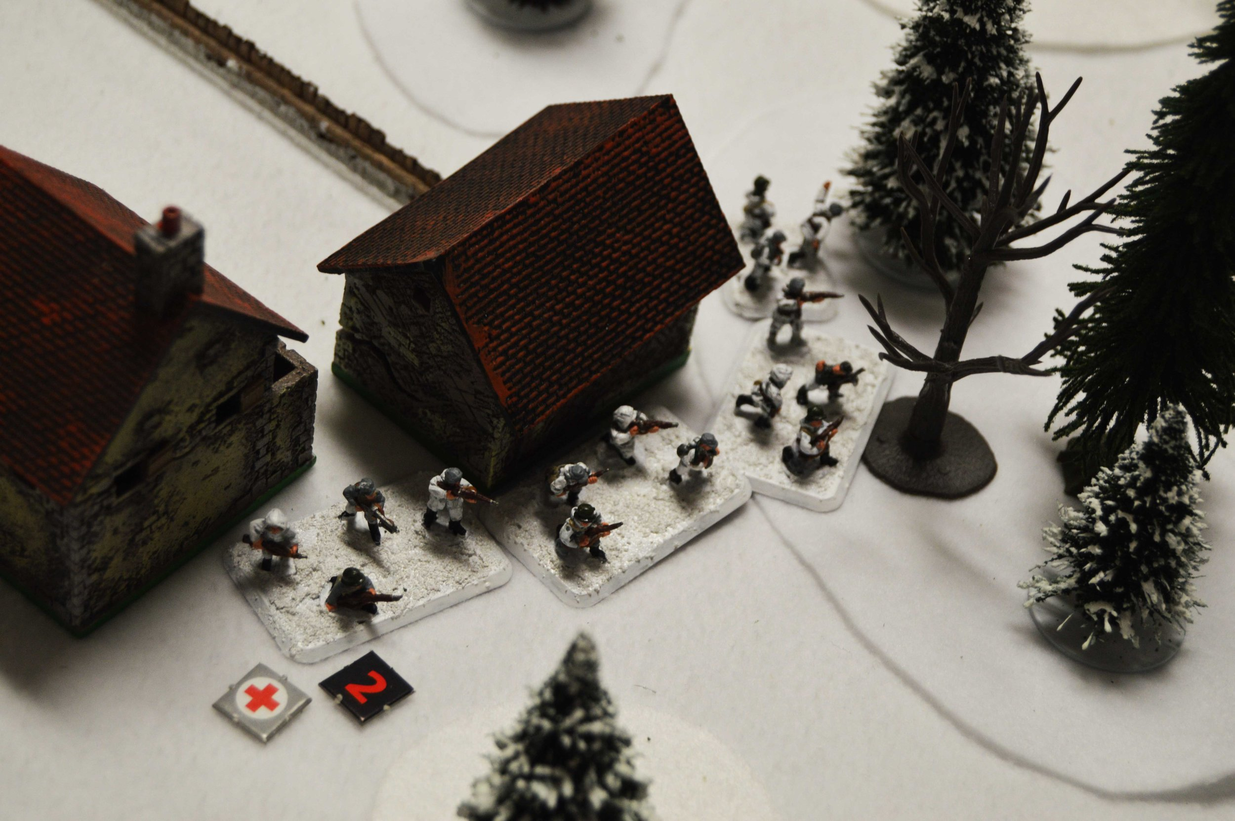 The Finns seize the moment, advancing from the safety of the farmhouse to storm the Soviet trenches.