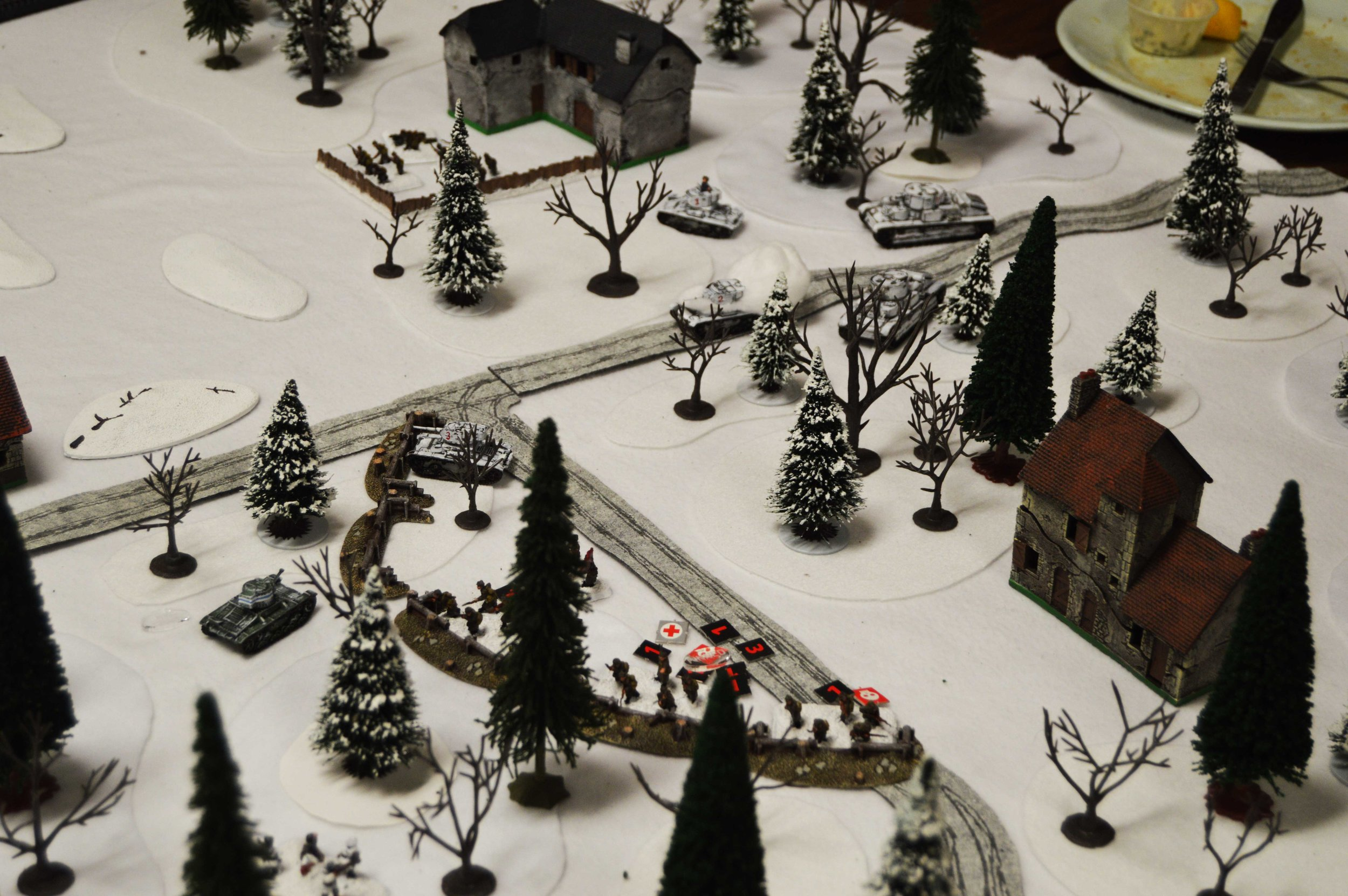 A Finnish Vickers tank makes a daring move to outflank the nearest T-26, while the Finnish infantry advance on the trench line. Unfortunately, more Soviet reinforcements arrive—two T-28 medium tanks.