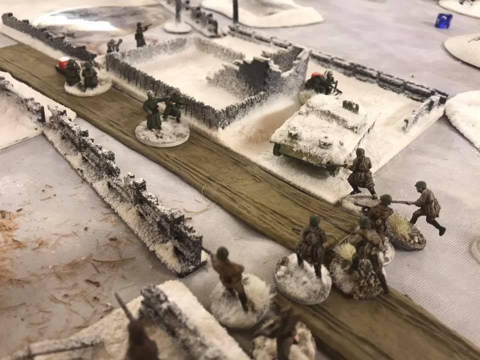 A much reduced Soviet vyod storms forward and finishes off the remnants of a German zug. It had been shot to bits by T-34s.