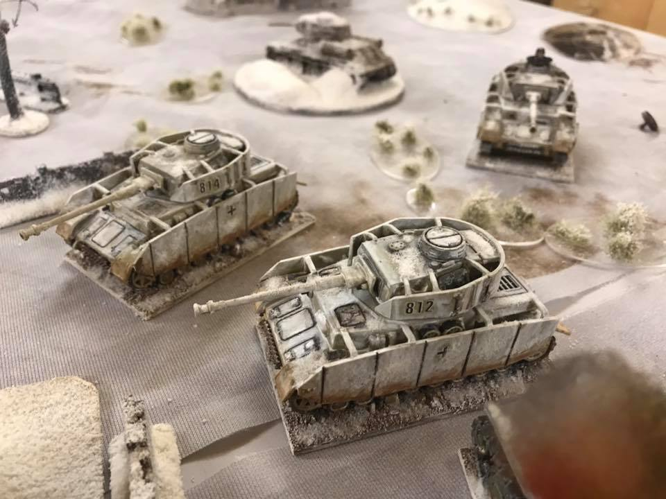 Panzer IV's HE the village.