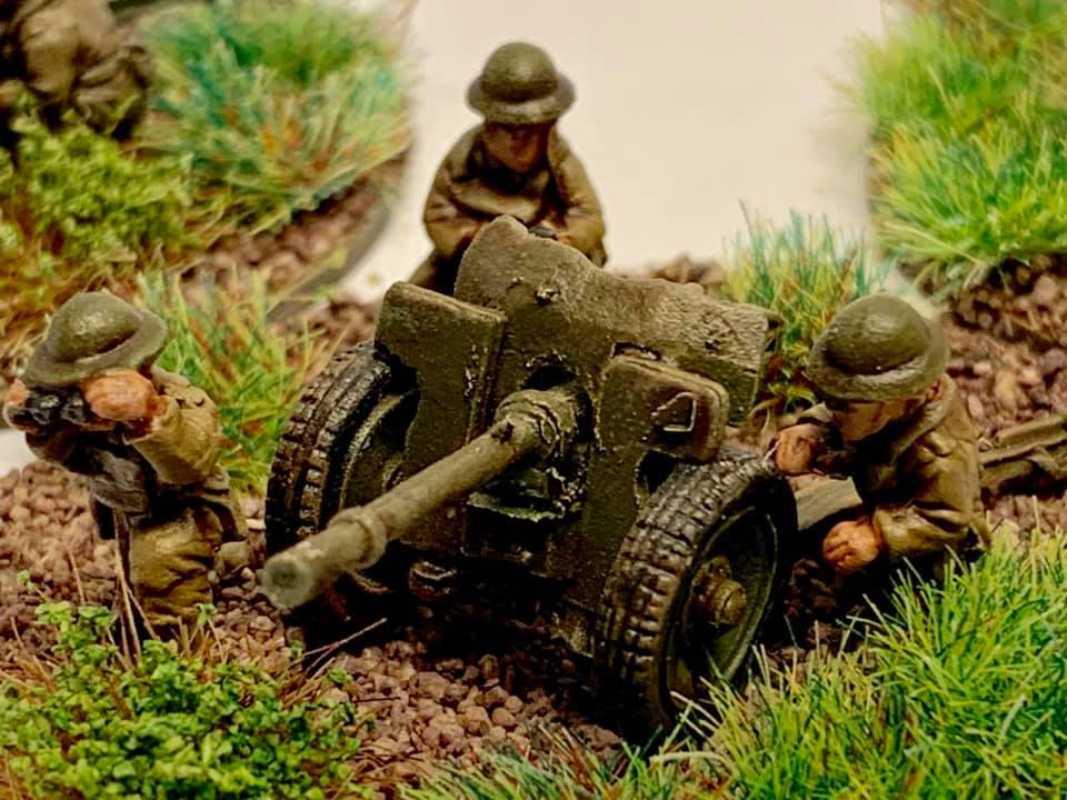 These are French Hotchkiss 25mm Anti tank guns. Bought by the British army and affectionately known as 'One pounders' these little guns packed a punch against Blitzkreig German Tanks.  These are 1/72 scale metal castings from Keiven at Lancer Miniatures. Painted in Tamiya and Vallejo paints, flock based on MDF and festooned in tufts from The Warpainter.