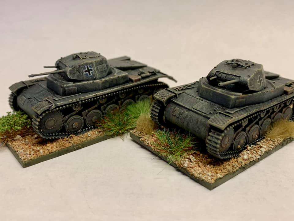 These 1/72 scale kits by S Models, Pz Kpfw II Ausf B, are excellent wargaming models. Painted in Tamiya and Vallejo paints, on a Warbases MDF base and textured using Jarvis cork pieces and sand, dry brushed and decorated with tufts from The Warpainter (via EBay)