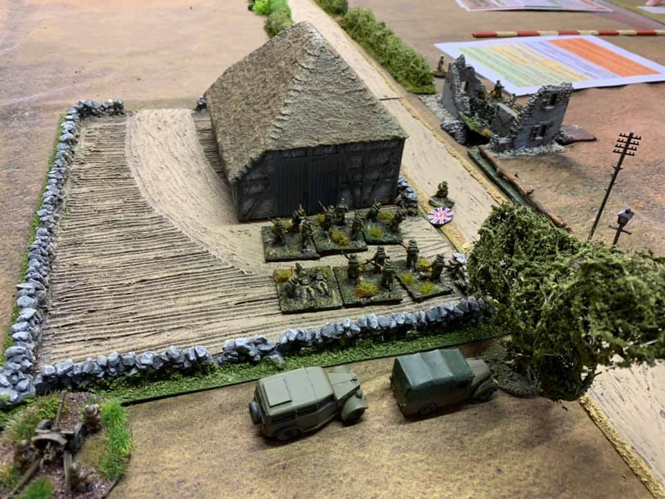 The second British platoon in the farm buildings on the St Martin Road