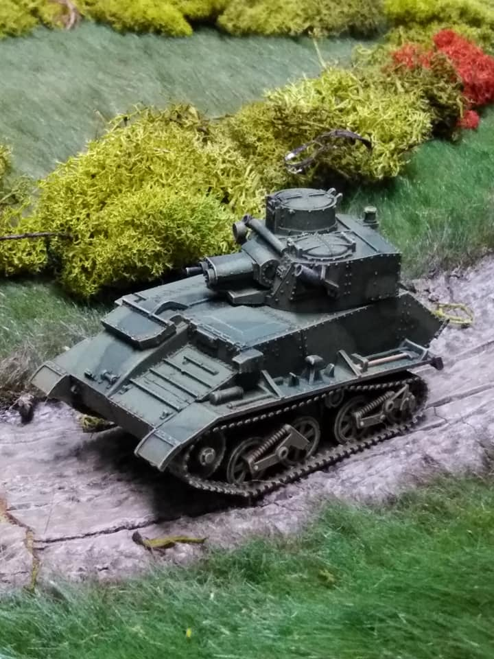 Vickers light tank reconnoitring down the road .