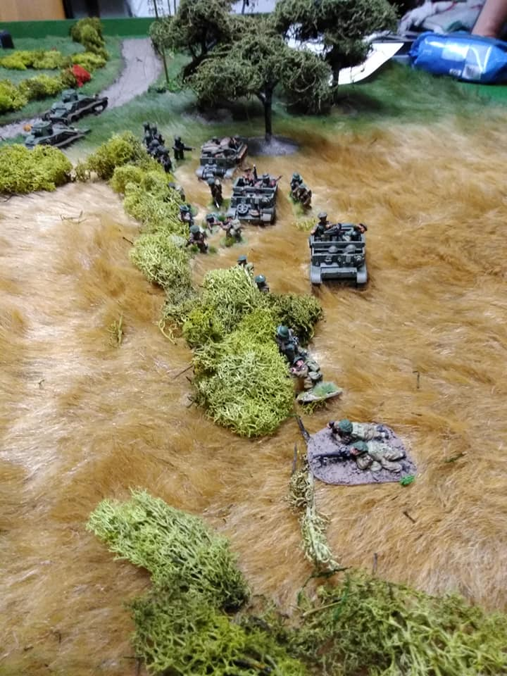 Carrier platoon takes up a flanking position.