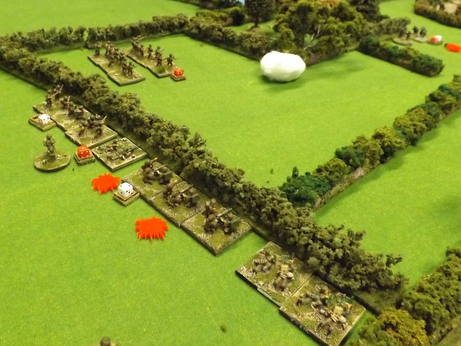 The covering fire goes in as the flank advances