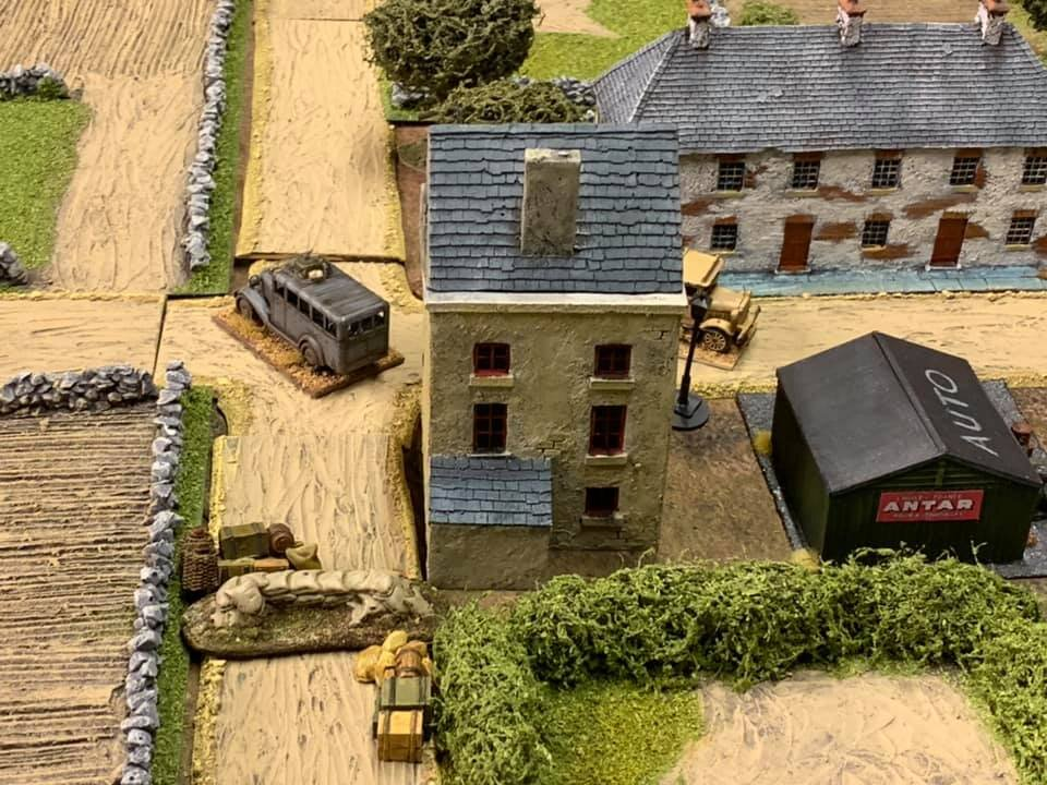 The British roadblock, abandoned lorry and bus. All to hinder the German advance.