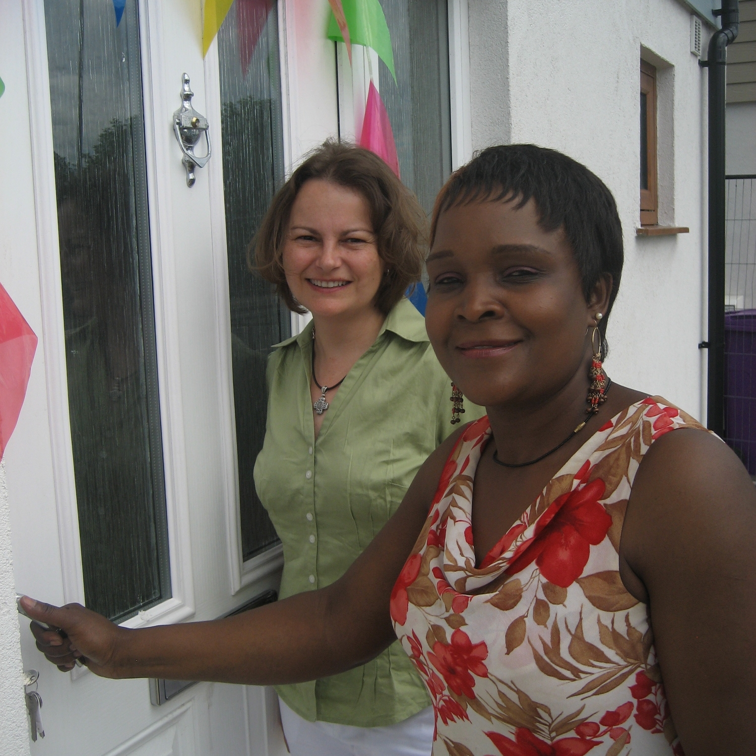 Home owner Julia Walimbwa (right) with HPBC Chair Rev Dr Shannon Ledbetter