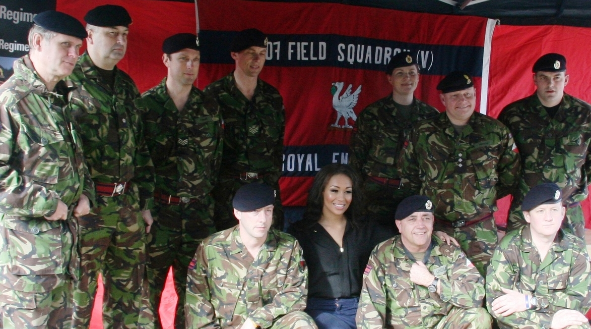 X Factor finalist and local girl Rebecca Ferguson with Army volunteers on the Toxteth site.
