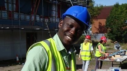Volunteers help build homes.jpg