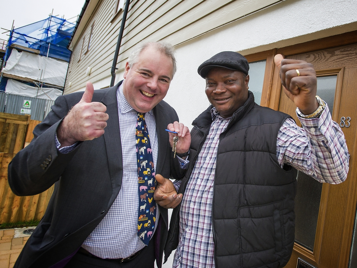 Richard Bacon MP hands over the keys to proud Home PartnerGeorge Anyakwo