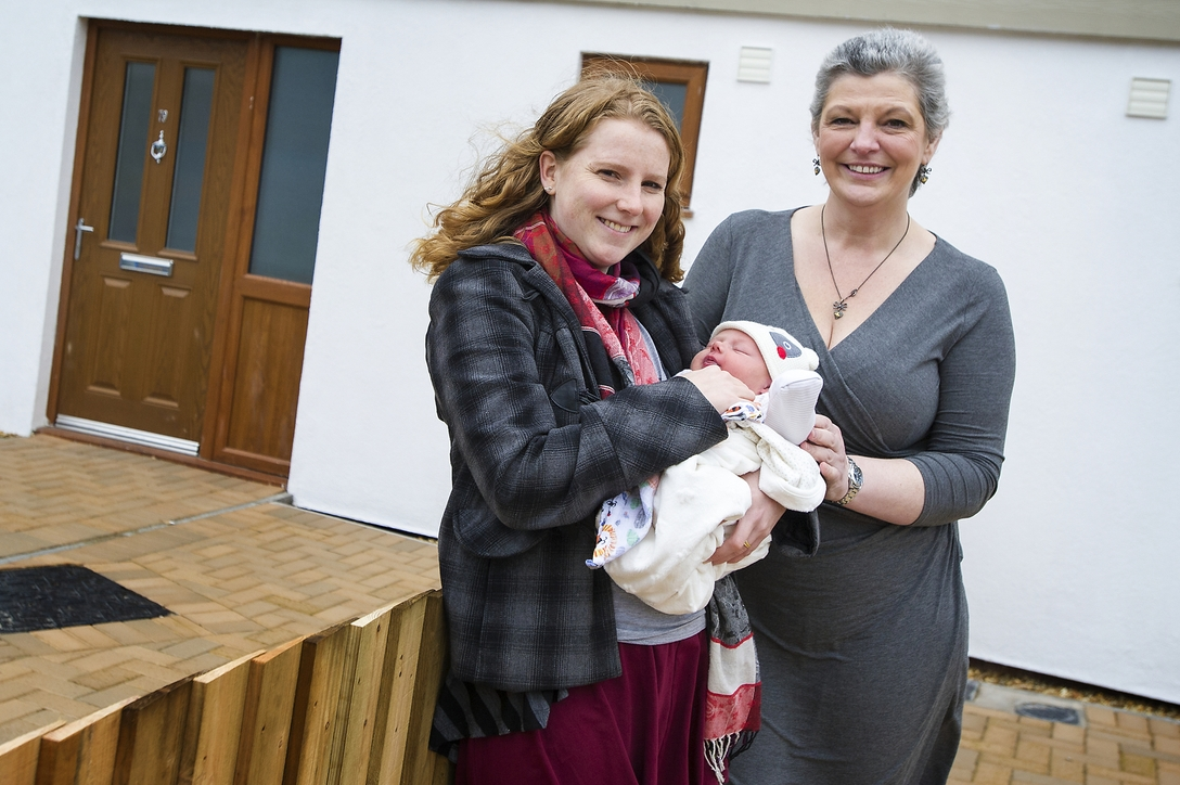 Cllr Ann O'Byrne, Liverpool City Council Cabinet Member for Housing and Community Safety with Home Partner Hannah Jones and baby Percy