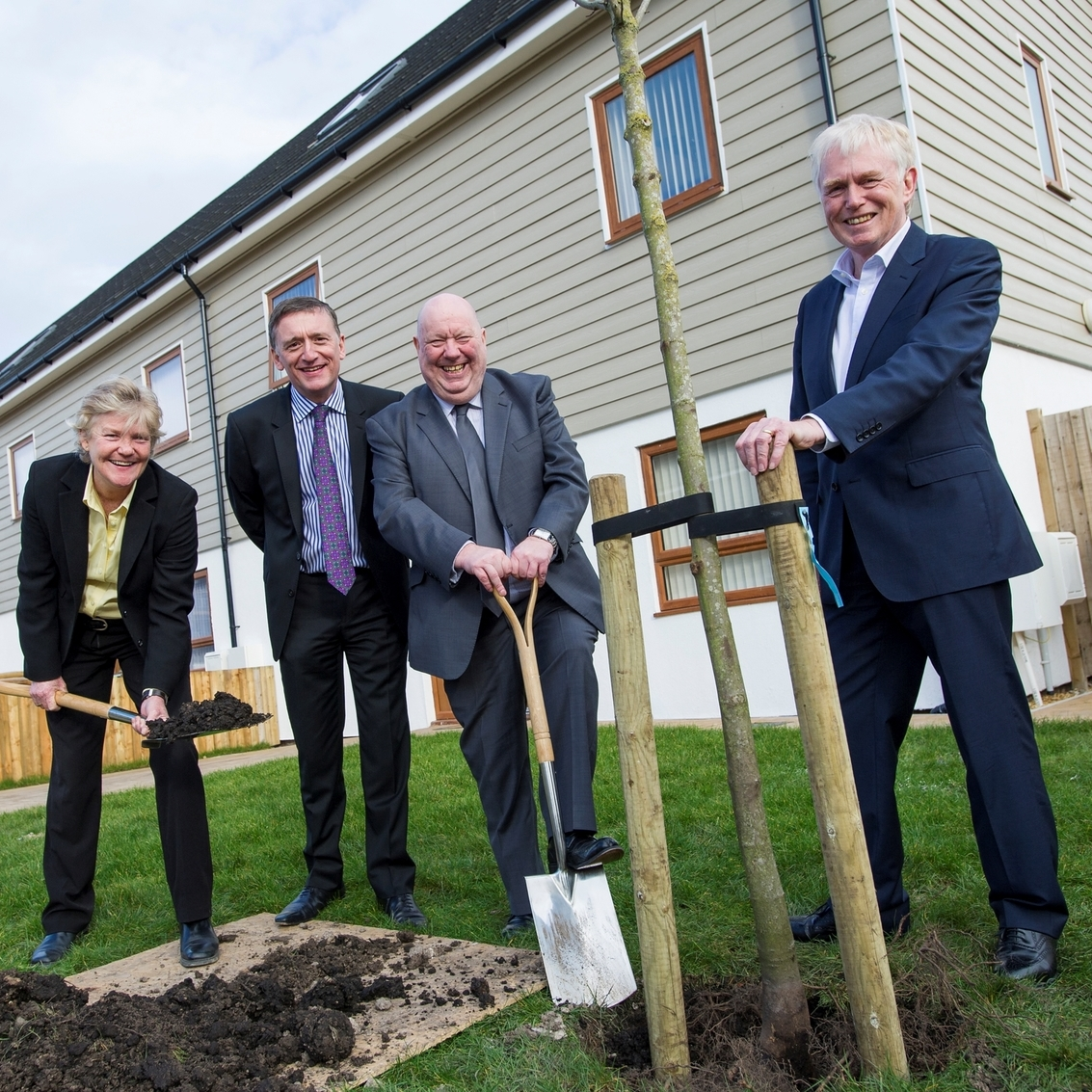 Planting one of the trees donated by the Mersey Forest, l-r, Liza Parry, chief executive of HPBC, Ian McDermott, Sanctuary's chief operating officer, Mayor Joe Anderson and Jim Gill, trustee, HPBC.