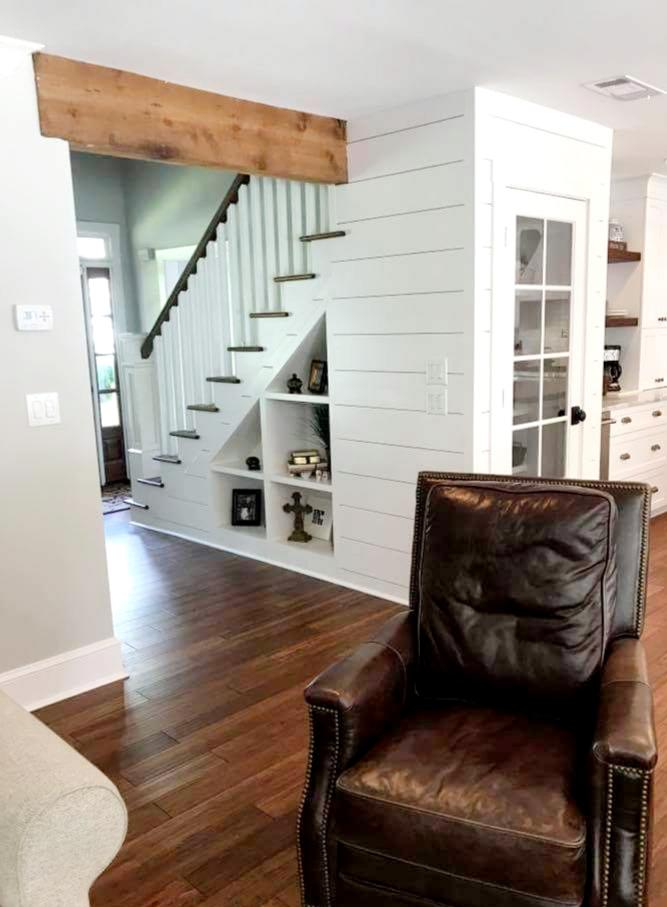 LUXE Homes Pro 040 den beam shelves stairs.jpg