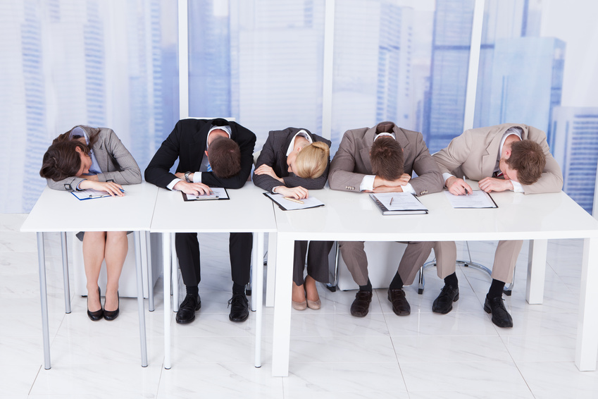 Fotolia #67694731 - Tired Corporate Personnel Officers At Table© apops