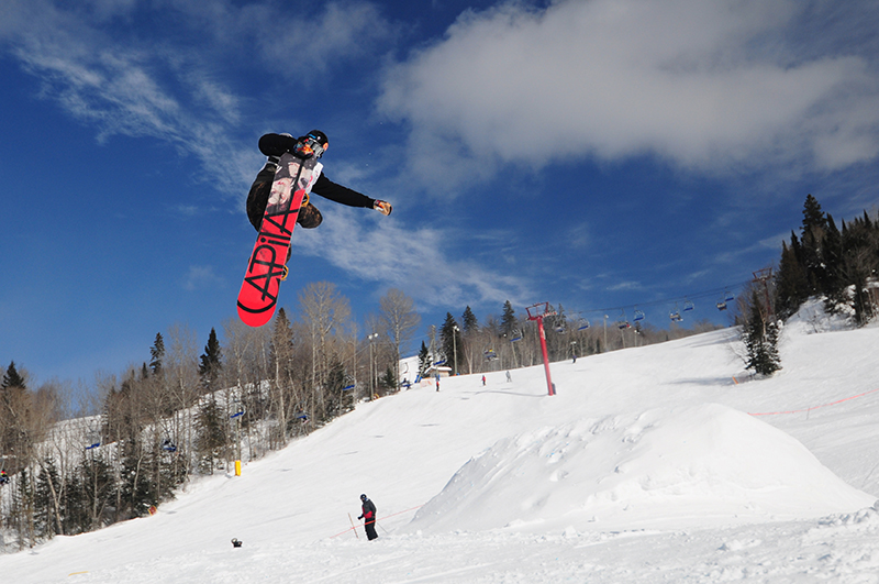 Travis Mooney blasts a huge 360 tail grab off the table top, taking third place in the Mens Snowboard Open Category, during SAFA Slopefest 2014 held at Searchmont Ski Resort over the weekend.