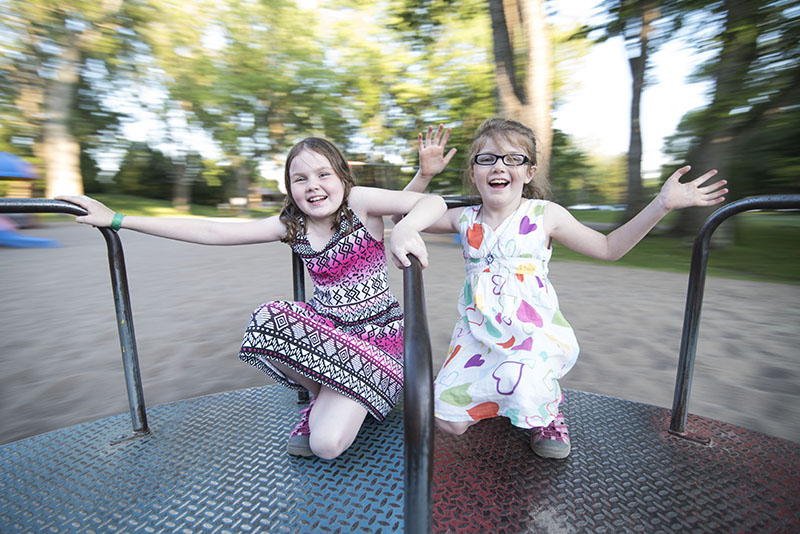 Out For A Spin: Sisters Shaye,9, and Kelsey, 7,Moran were celebrating the end of the school year, enjoying the sun and warm weather on the Merry-Go-Round at Bellevue Park on Friday June 26, 2015.