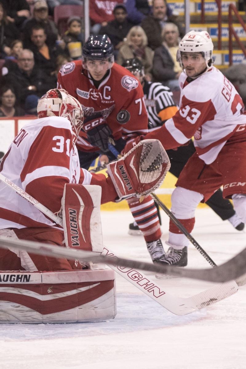 Ali Pearson/ Sault This Week  Greyhound goalie Brandon Halverson makes a close-in save against Oshawa.