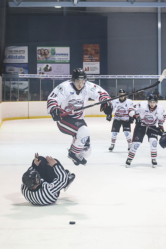 Bird In Flight- Soo Thunderbirds rookie Boris Katchouk goes airborne in pursuit of puck, while linesman take a tumble during recent Northern Ontario Jr. Hockey League action against visiting Kirkland Lake Gold Miners at the John Rhodes Arena.