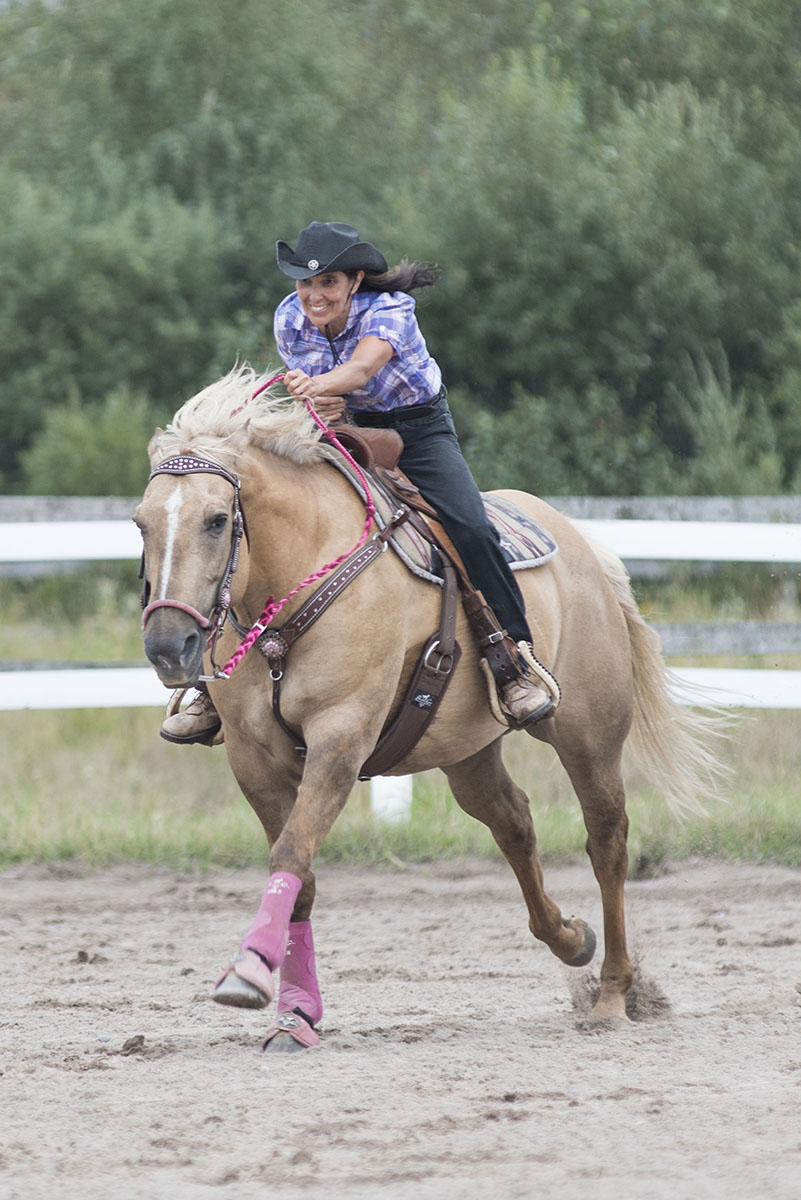 Heading for Home: Laurie Ferdman and Hannah head for home taking 1st Place in the barrels competition of the fun show Saturday August 29, 2015 at Strathclair Farms, also known as The Sault Horse and Pony Club.