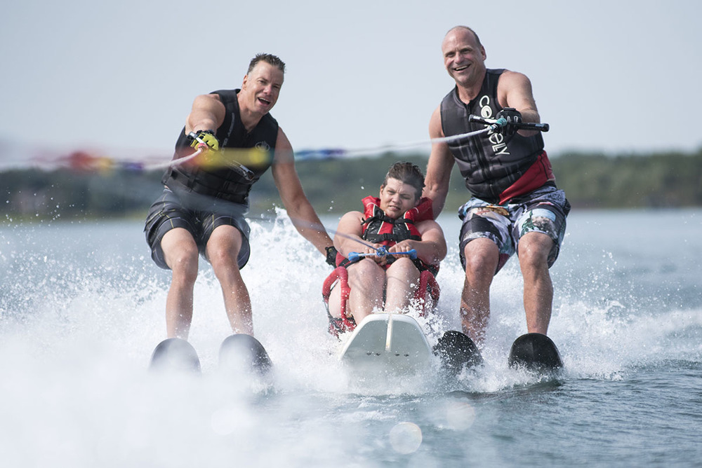 Skiability: Dedicated volunteer Gavin Grant assits Kim Anderson with the help of Tim Janzen at Bells Point Saturday August 23, 2015.  Skiablilty Algoma is one of only two accessible waterskiing programs in Ontario.