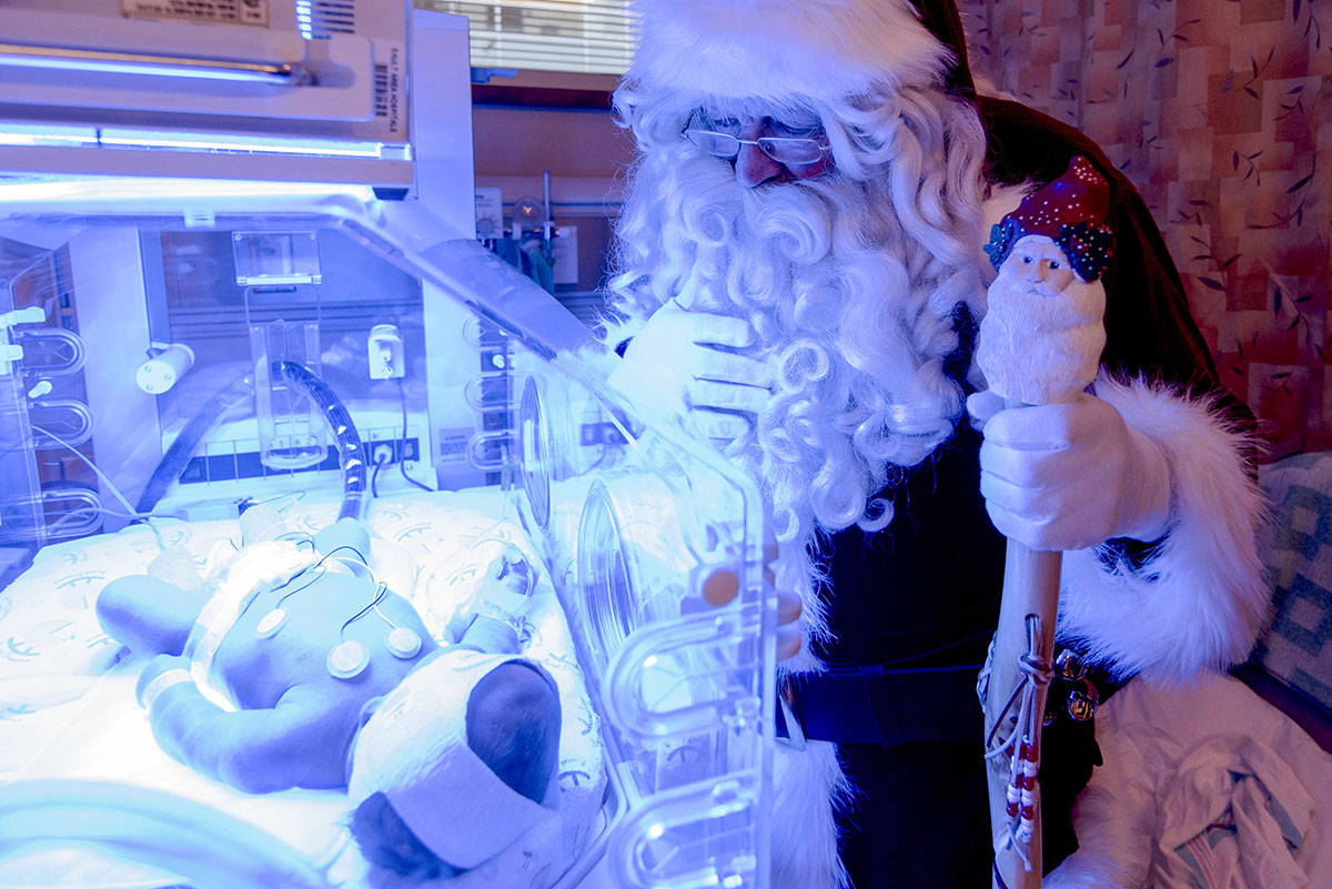 Cashis Korytko sleeps peacefully in an incubator in the NICU unit at Sault Area Hospital, Friday December 11, 2015, only a few days old and Santa takes the time to look in on one of the newest additions to his list.