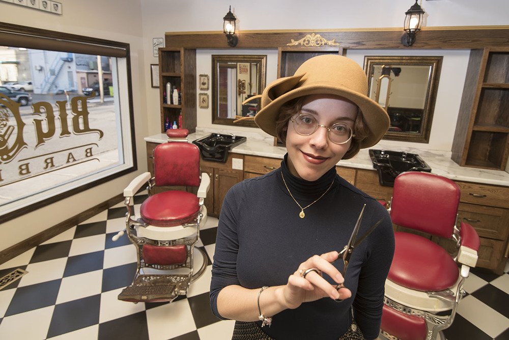 Big Guns: Paula D'Agustino stands in her new Barber Shop, NOvember 20, 2015. Stepping through the doors is like stepping back in time, offering hair cuts, beard trims and car talk.