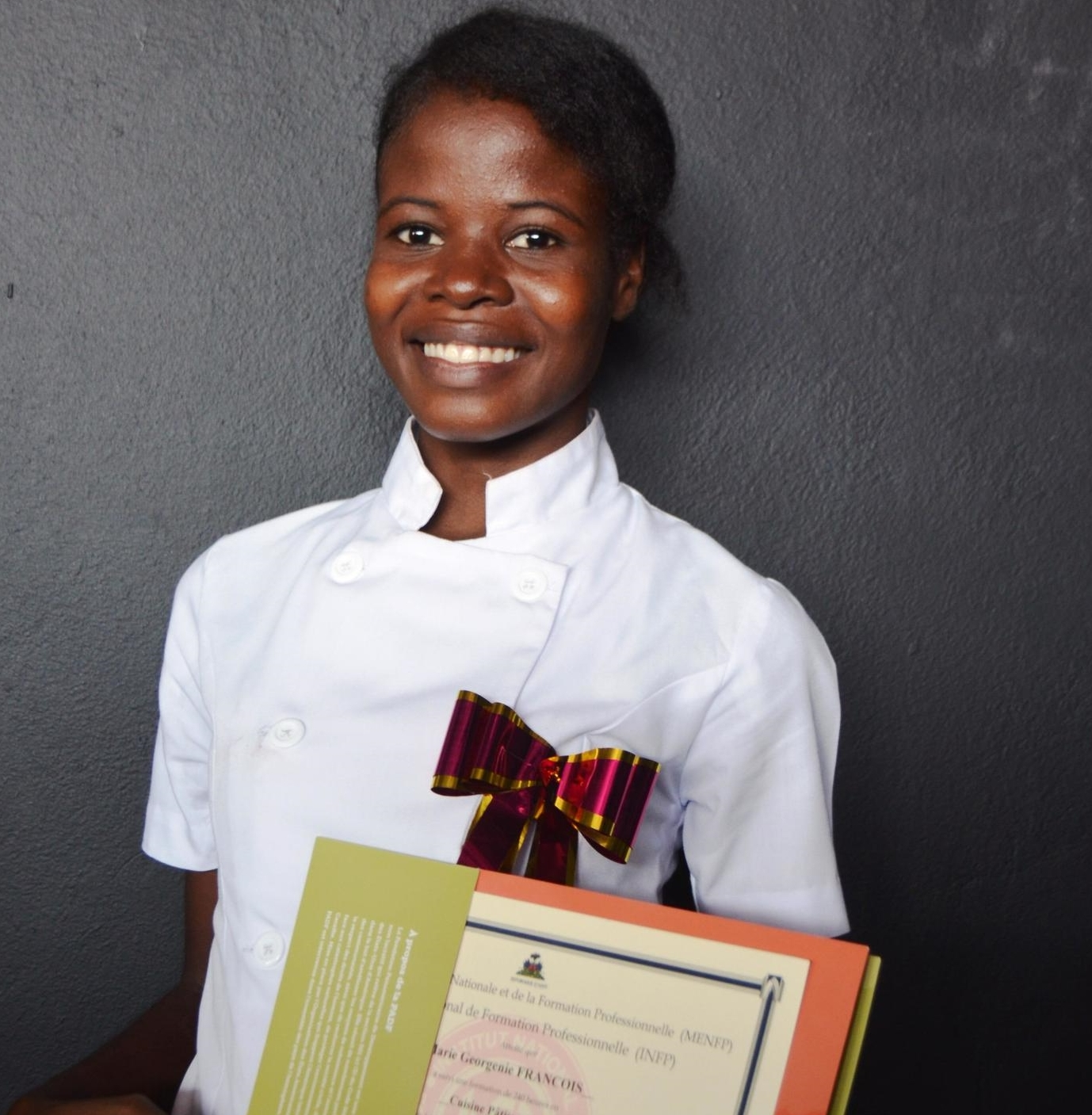 François Marie Georgénie, 24, lives in Cité Soleil. She now has more job opportunities as a result of her training incooking and pastry.