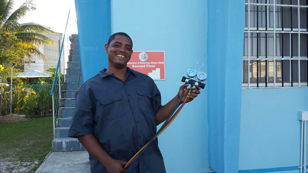 Bowen displays the refrigeration equipment he was able to purchase with a grant from the Pan American Development Foundation (PADF).