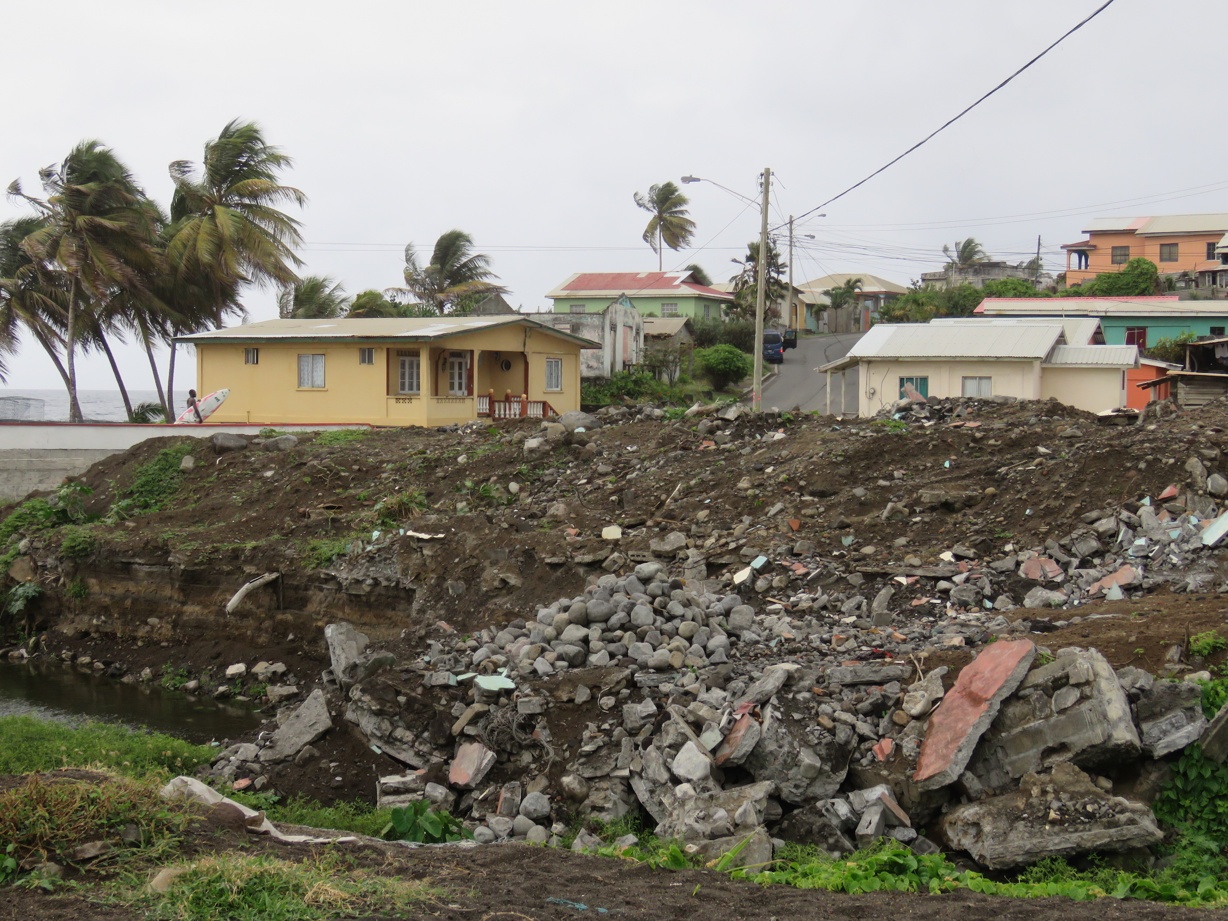 Rubble marks the spot where a house collapsed into the riverbank during the 2013 floods in Natalia's neighborhood of Georgetown.