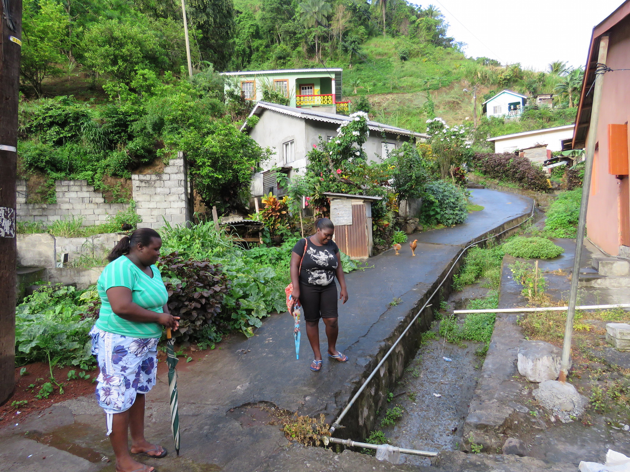 Residents point out the drainage system, which was clogged during the floods.