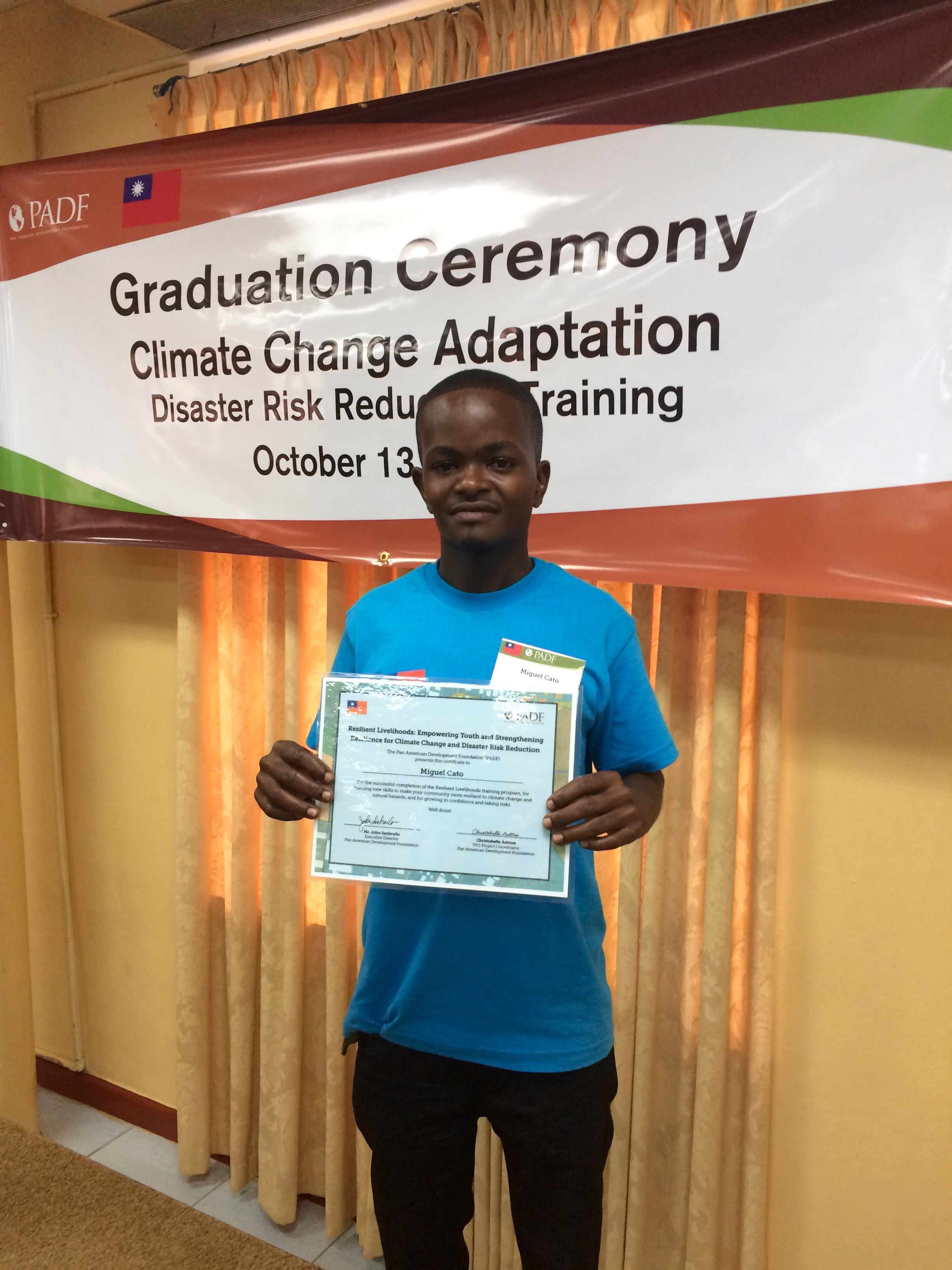 A graduate from the island of Bequia holds his certificate.