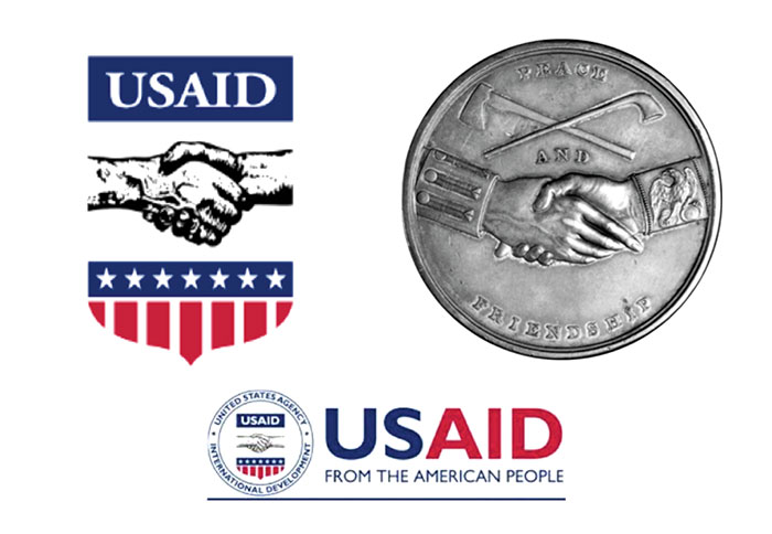 The USAID logo we know today bears a distinct resemblance to the Jefferson Peace Medal, as shown here. Peace and friendship medals minted in silver by the U.S. government were an aspect of diplomacy with Native Americans and others during the 18th and 19th centuries.   Jefferson Peace Medal / Oregon Historical Society