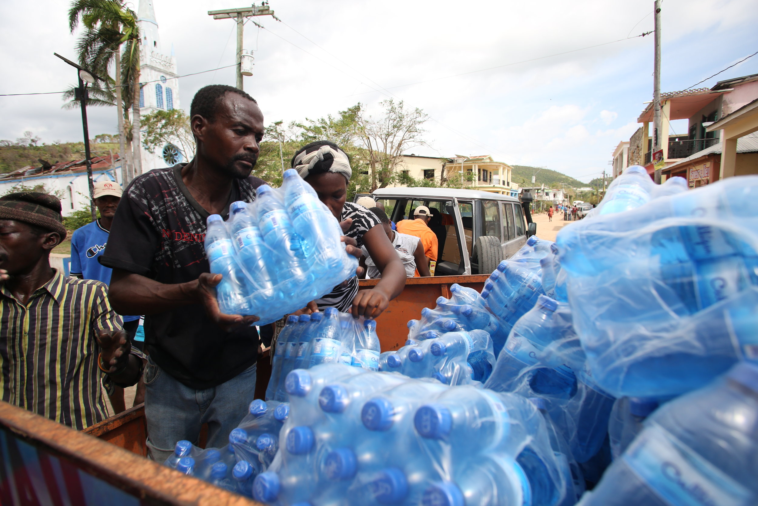 PADF staff deliver clean water to families affected by Hurricane Matthew in Cavaillon, Haiti (Jeanty Junior Augustin)