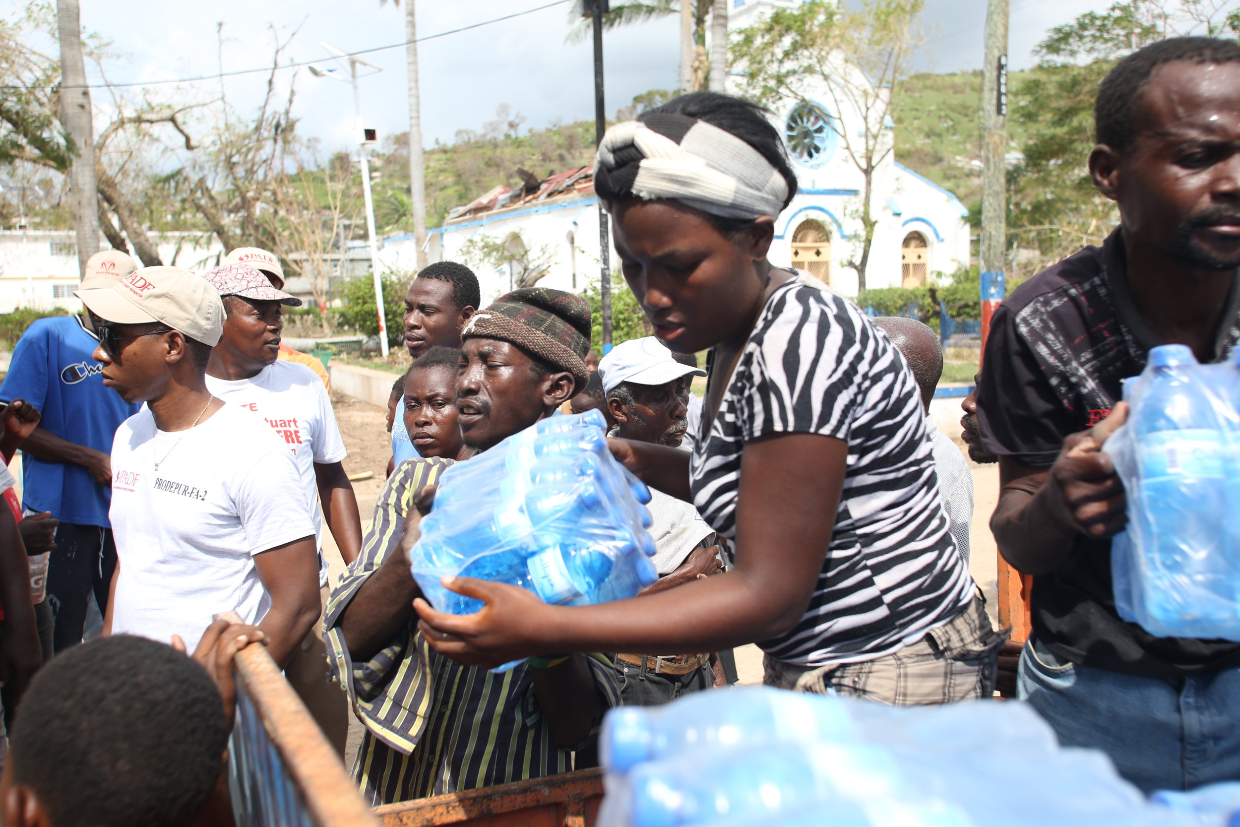 With cases of cholera on the rise in hard-hit regions, clean water is extremely important for victims of Hurricane Matthew. (Jeanty Junior Augustin)