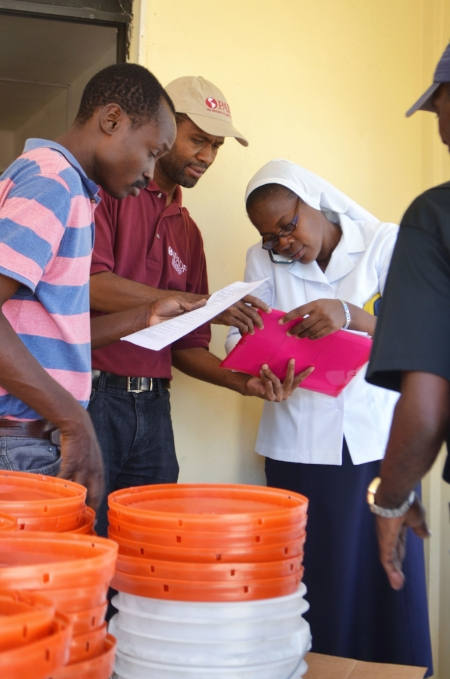 Sister Yveline Fevrier of Stella Maris in Port-à- Piment receives her school's water filters.