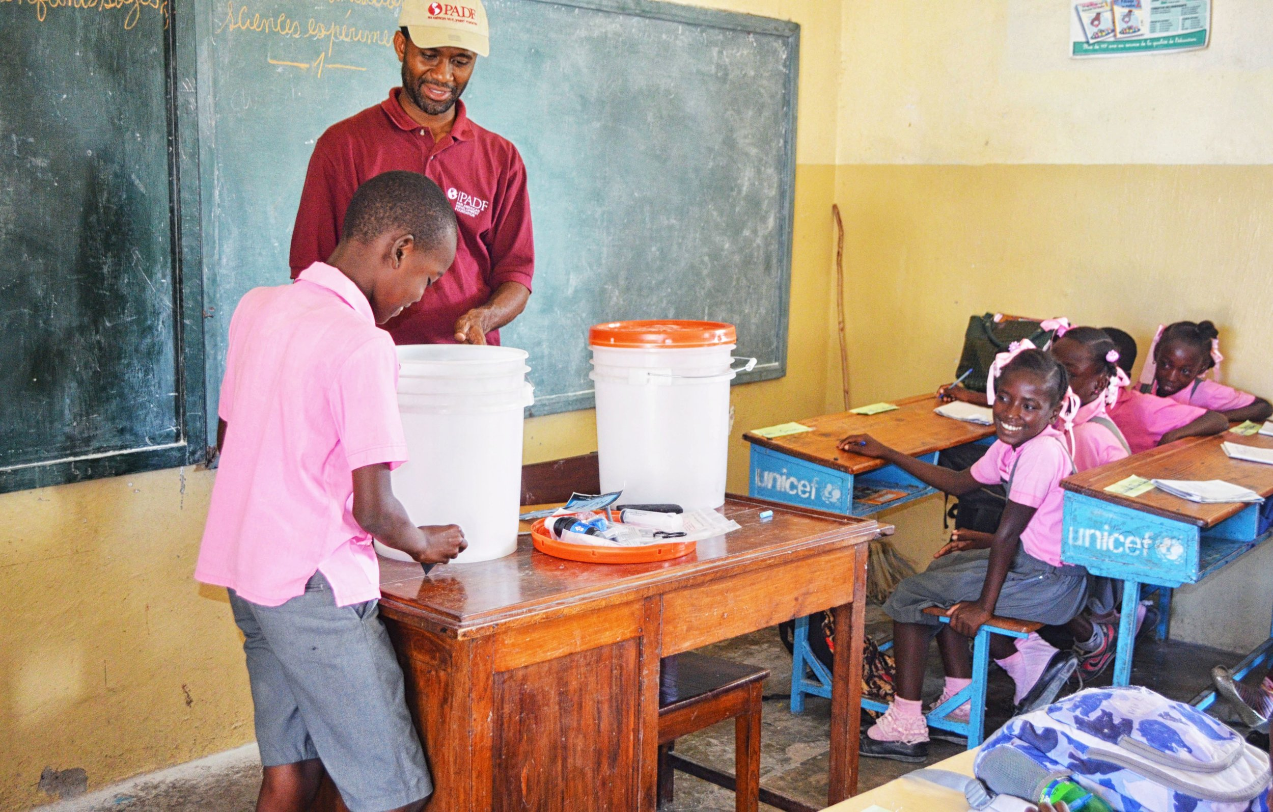Haitian students learn how to use and maintain the new filters