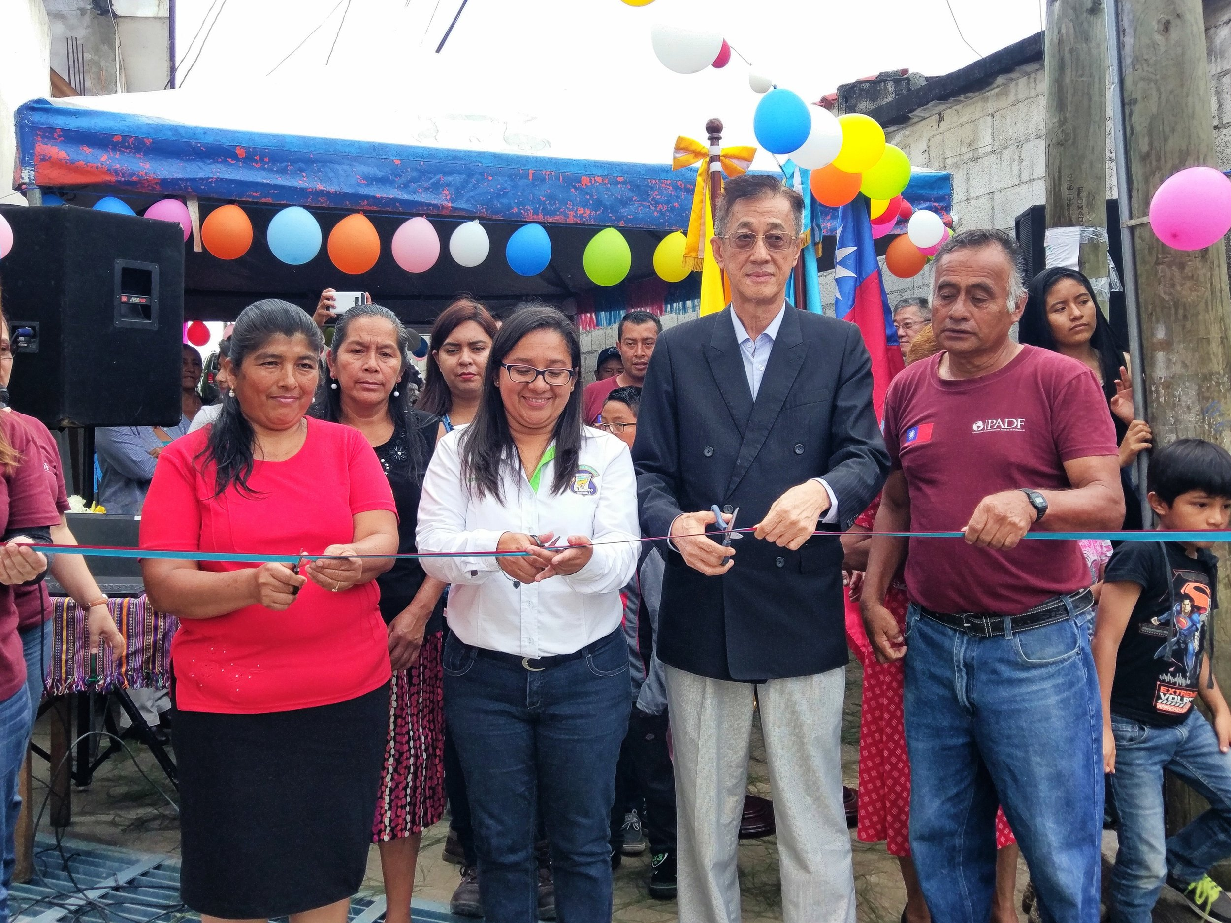 John Lai, Taiwanese Ambassador to Guatemala, celebrates with local leaders and PADF at the ribbon cutting ceremony on September 23.
