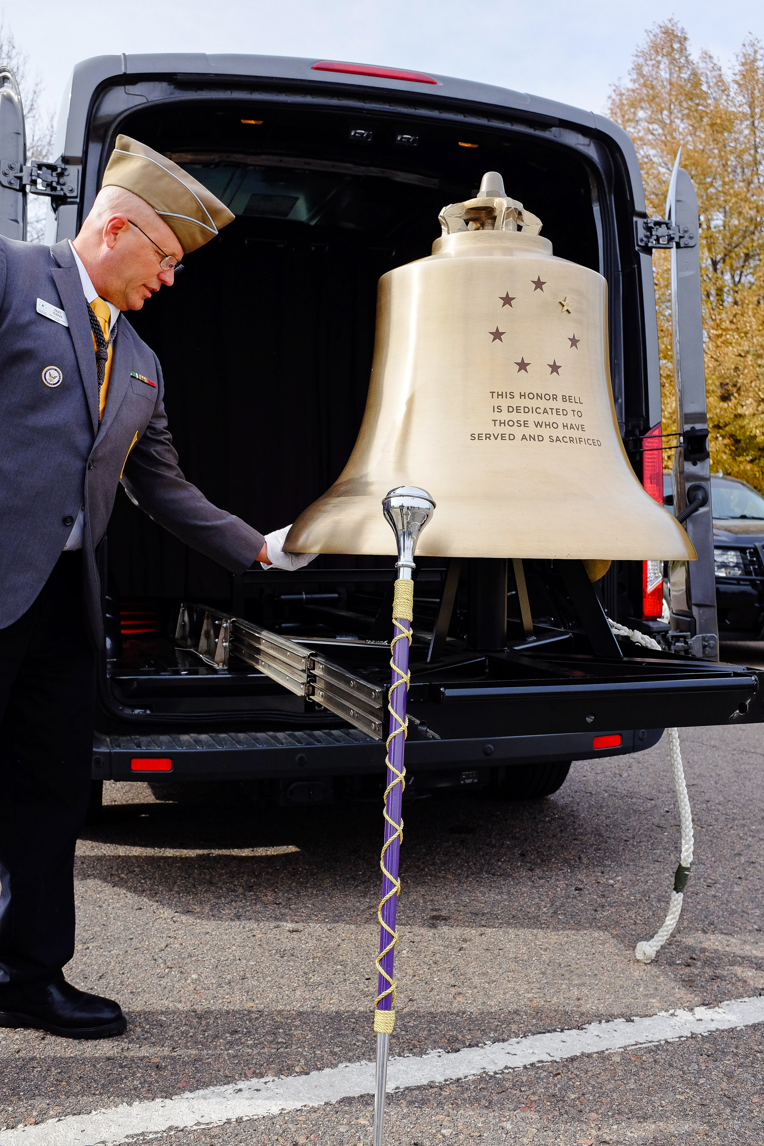 Tracy Turner inspecting the Honor Bell prior to a Bell Honors service for unclaimed veteran remains in 2018.