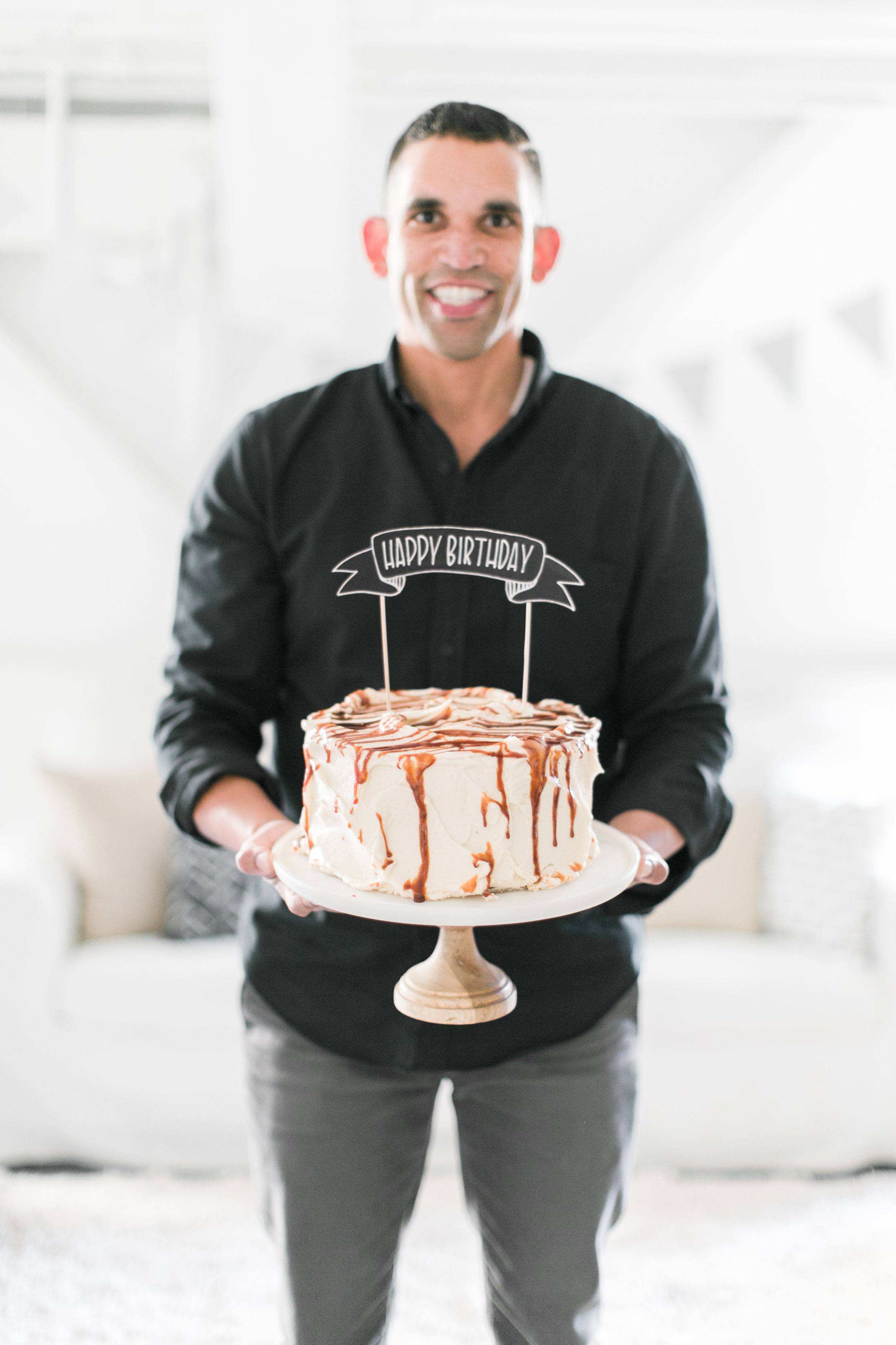STEVE DISPLAYING OUR CUSTOM CAKE TOPPER.
