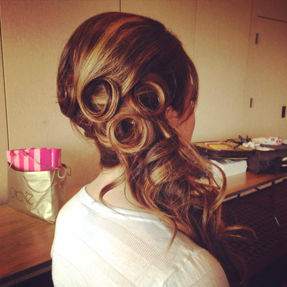 Pinned curls are a great way to create unique texture with a wedding hairstyle.  The hair flowing to one side gives a bride a way to have her hair more formal but not all the way up if she is not comfortable with an updo.  Hair texture needed:  Medium to thick  Hair length needed: Medium to long
