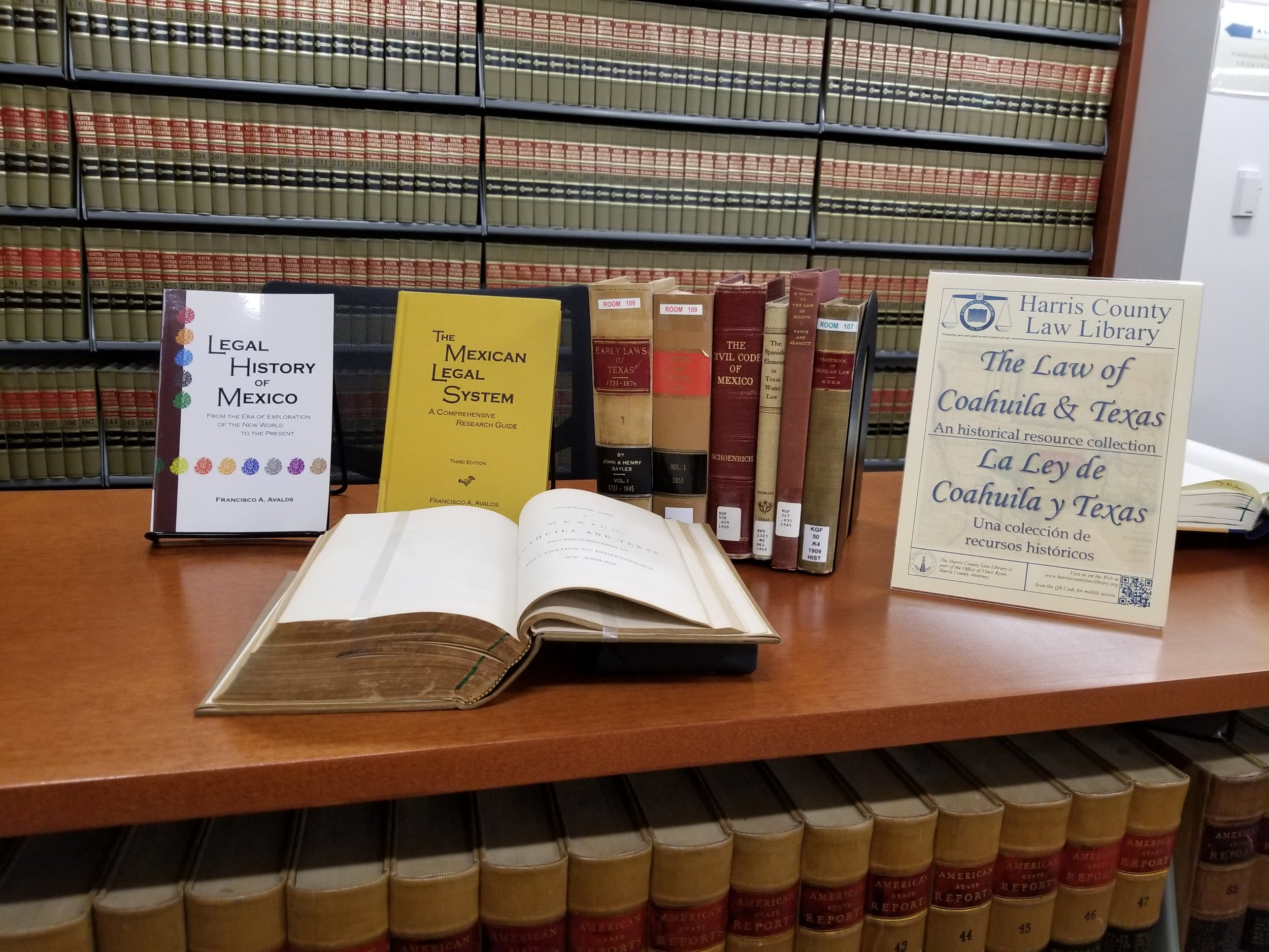Photo of exhibit featuring the Harris County Law Library's The Law of Coahuila and Texas : An historical resource collection.