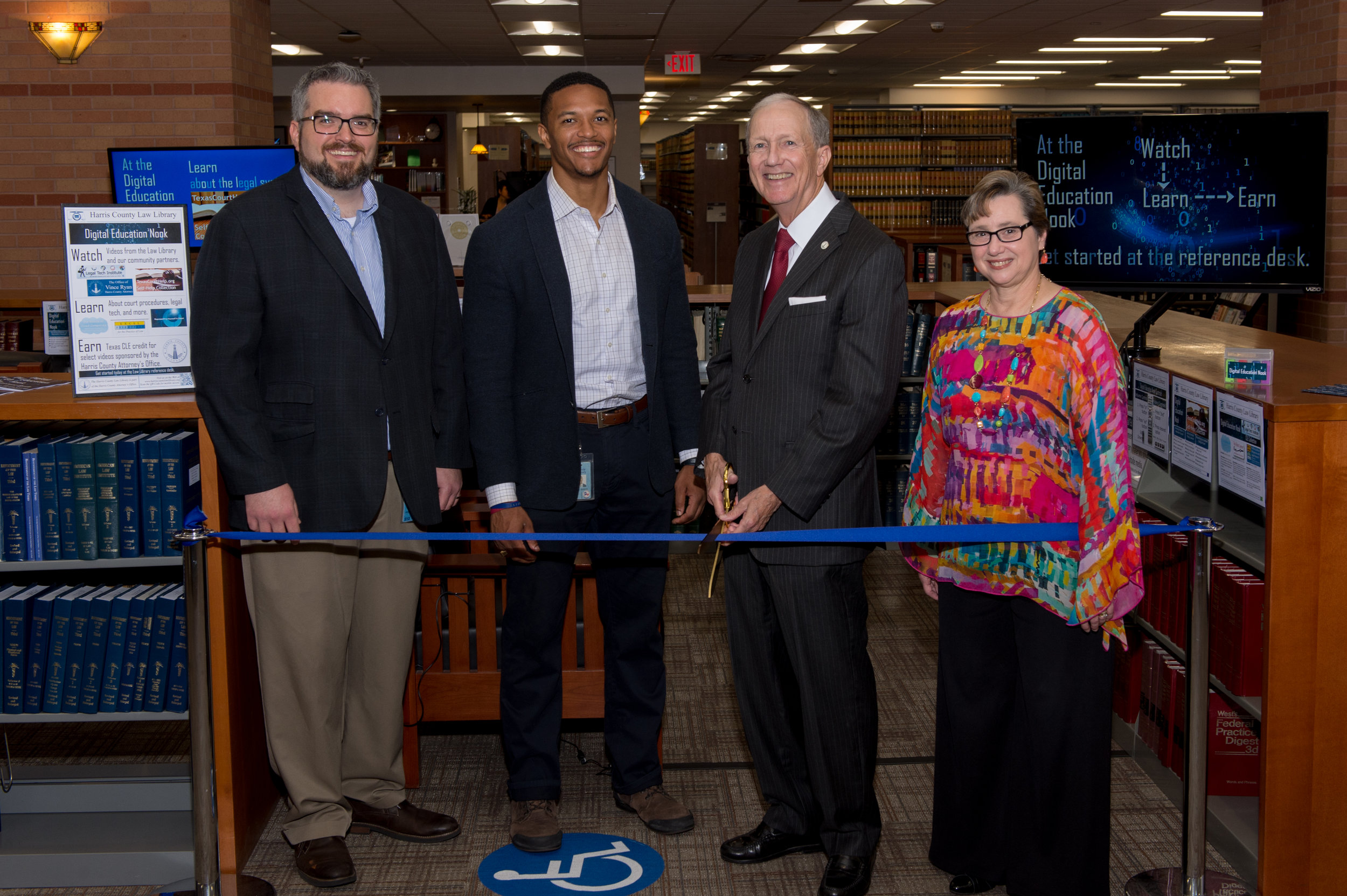 Harris County Attorney Vince Ryan  {center right}  cut the ribbon on the new addition with Harris County Law Library Director Mariann Sears  {right} , Law Library Deputy Director Joseph Lawson {left} , and Gabe Baker  {center left} , Community Outreach Specialist from the Harris County Judge's Office.
