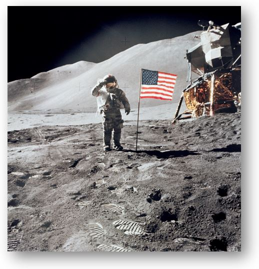 Astronaut David Scott Gives Salute Beside U.S. Flag (Aug. 1, 1971)