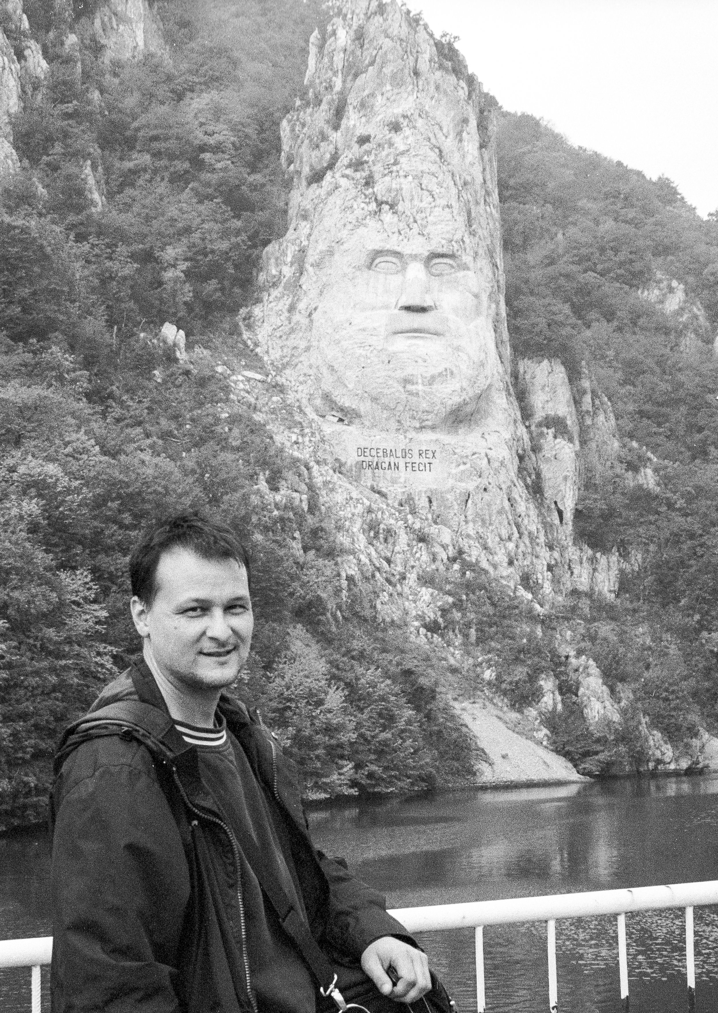 Dan in front of Europe's tallest rock sculpture. The Decebalus Monument in Romania. (Photo taken by my taxi driver who oddly enough looked like the late TV journalist Tim Russert.